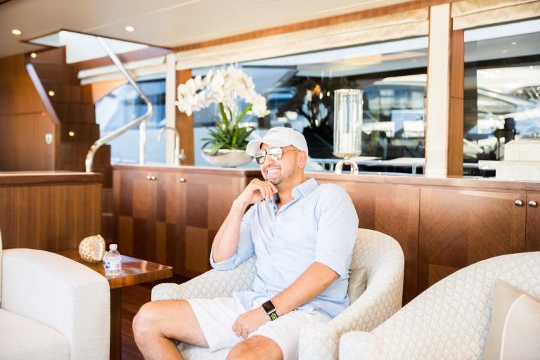 Gianpierre Giusti Sitting Down on Luxury Yacht