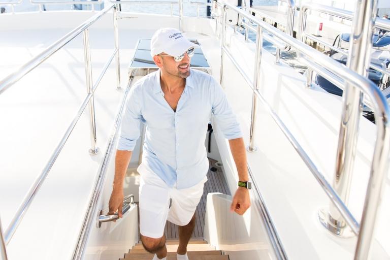 Gianpierre Giusti on steps of Luxury Yacht